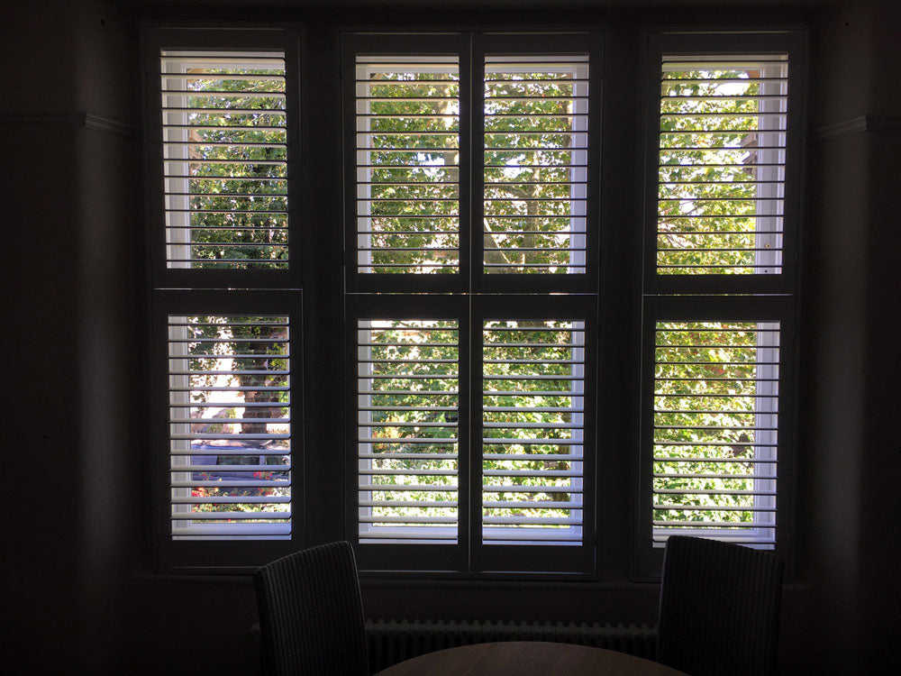 tier on tier wooden window shutters paul christian bristol bath
