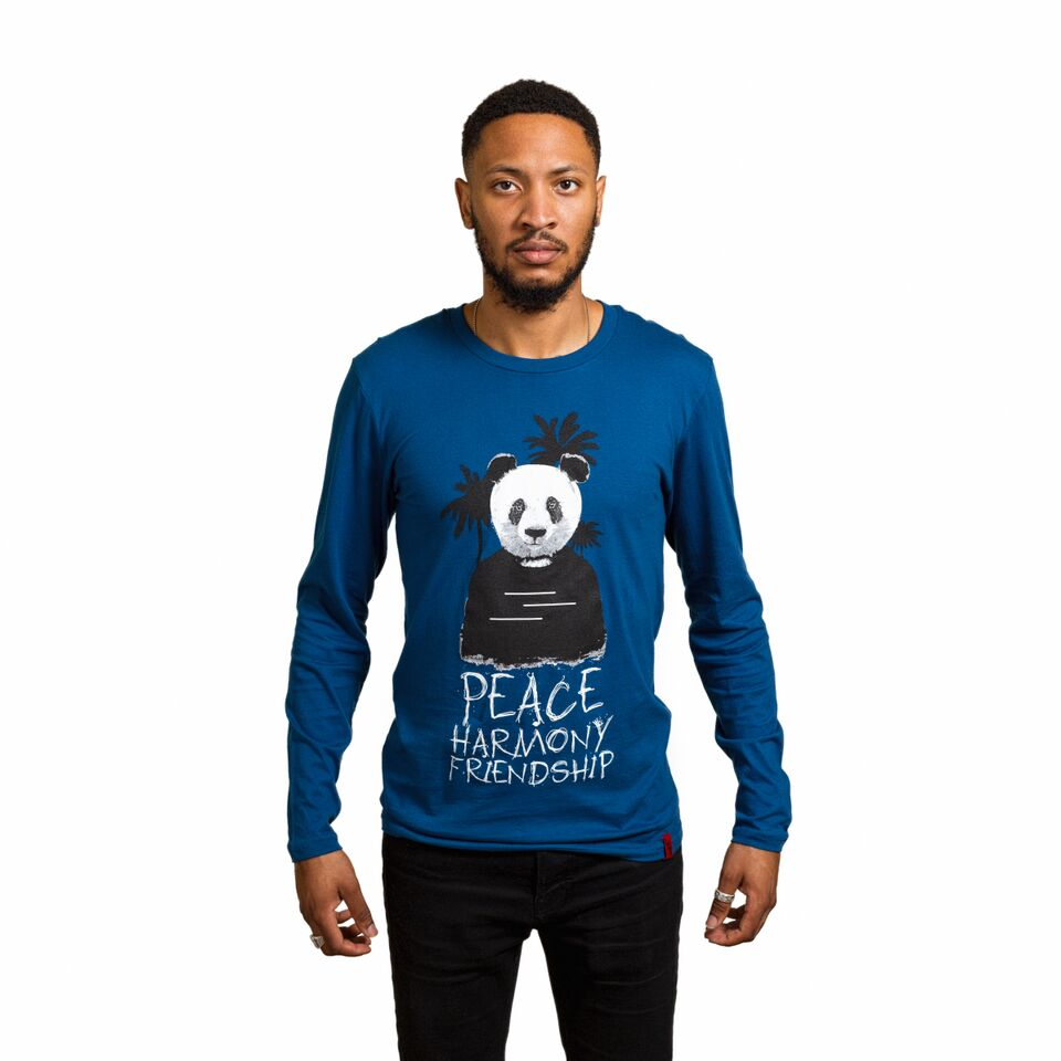 "Male wearing a cool blue colored long sleeve shirt with a tree and panda that says ""peace, harmony, friendship"""