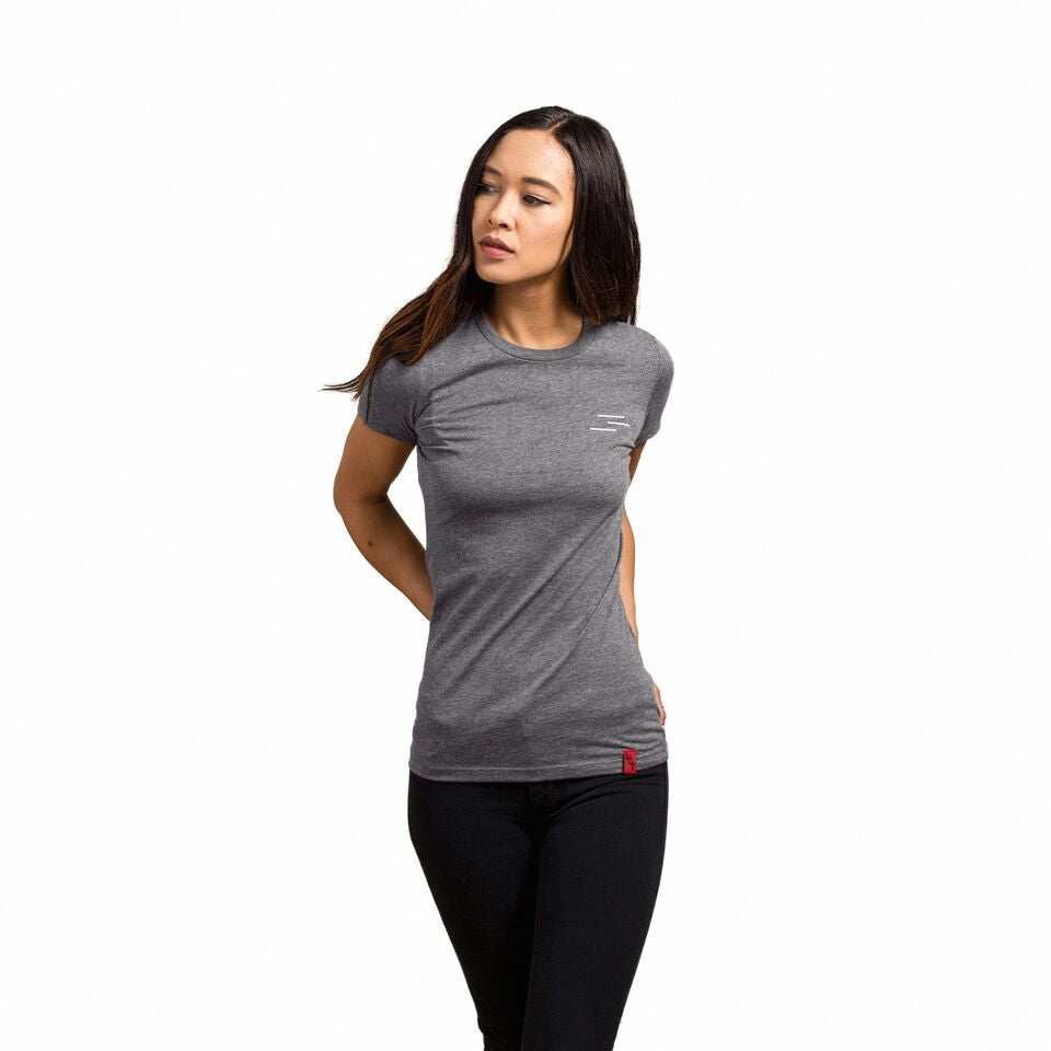 Woman wearing an athletic grey shirt with the Line of Vision logo. Three Lines