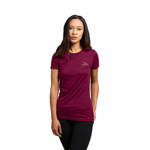 Woman wearing a maroon shirt with the Line of Vision logo. Three Lines