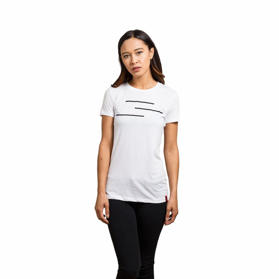 Woman wearing a white shirt with the Line of Vision logo. Three Lines