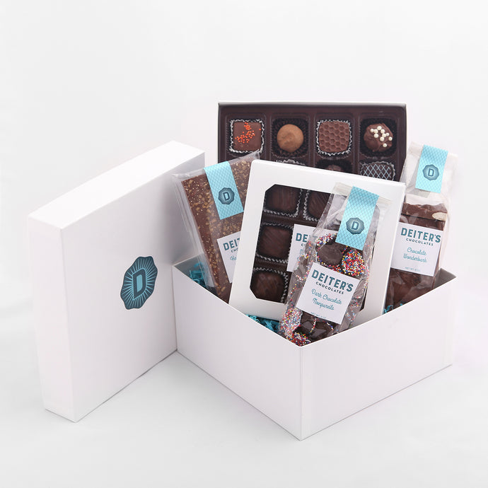 gift box of hazelnut toffee bar, 16-piece truffles, chocolate wonder bark, 9-piece caramels and bag of nonpareils