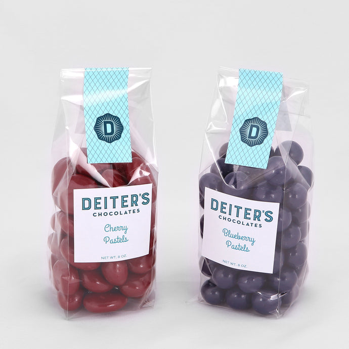 bags of cherry and blueberry pastel candies.