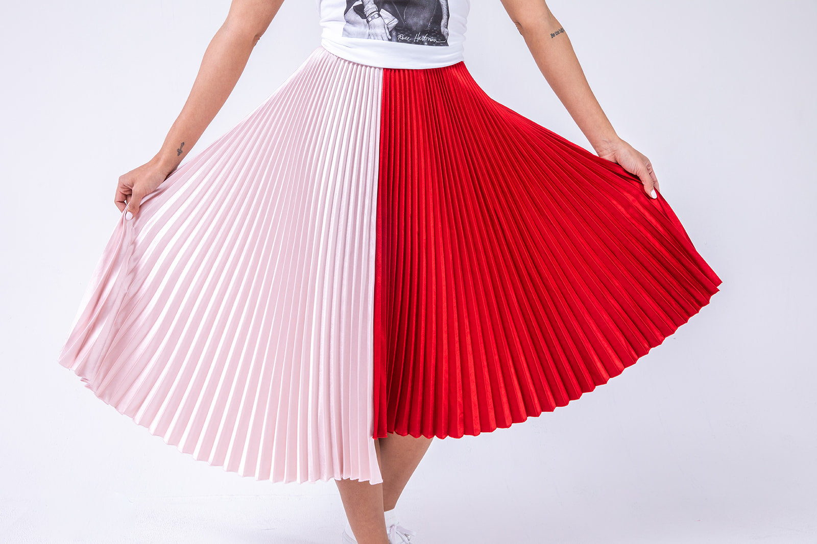 Pink and red pleated skirt features our #SnagDat section of amazing sale finds from our store sales floor.