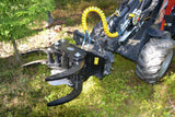 Tree shear grapple for skid steers, track loaders and wheeled loaders.