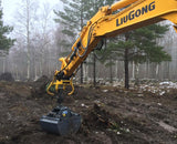 Excavator using universal attachment for log grapples and buckets from grapplepros.com