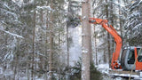 JAK tree shear working in the forest on a small excavator