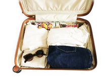 tuscany blingsling travel jewellry bag in small suitcase