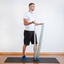 Load image into Gallery viewer, The industry standard in rehabilitation aid and physiotherapy, Coresteady Resistance Therapy bands provide safe and effective workouts that allow you to be in total control of every movement. Male exercising arm double arm curls.