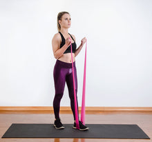 Load image into Gallery viewer, The industry standard in rehabilitation aid and physiotherapy, Coresteady Resistance Therapy bands provide safe and effective workouts that allow you to be in total control of every movement. Female exercising arm curl.