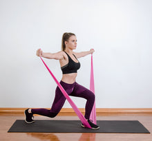 Load image into Gallery viewer, The industry standard in rehabilitation aid and physiotherapy, Coresteady Resistance Therapy bands provide safe and effective workouts that allow you to be in total control of every movement. Female exercising lateral raise squat lunge.