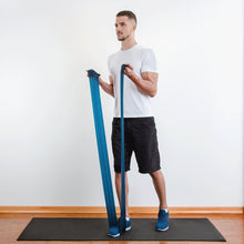 Load image into Gallery viewer, The industry standard in rehabilitation aid and physiotherapy, Coresteady Resistance Therapy bands provide safe and effective workouts that allow you to be in total control of every movement. Male exercising arm double arm curl.