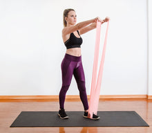 Load image into Gallery viewer, The industry standard in rehabilitation aid and physiotherapy, Coresteady Resistance Therapy bands provide safe and effective workouts that allow you to be in total control of every movement. Female exercising shoulder raise.