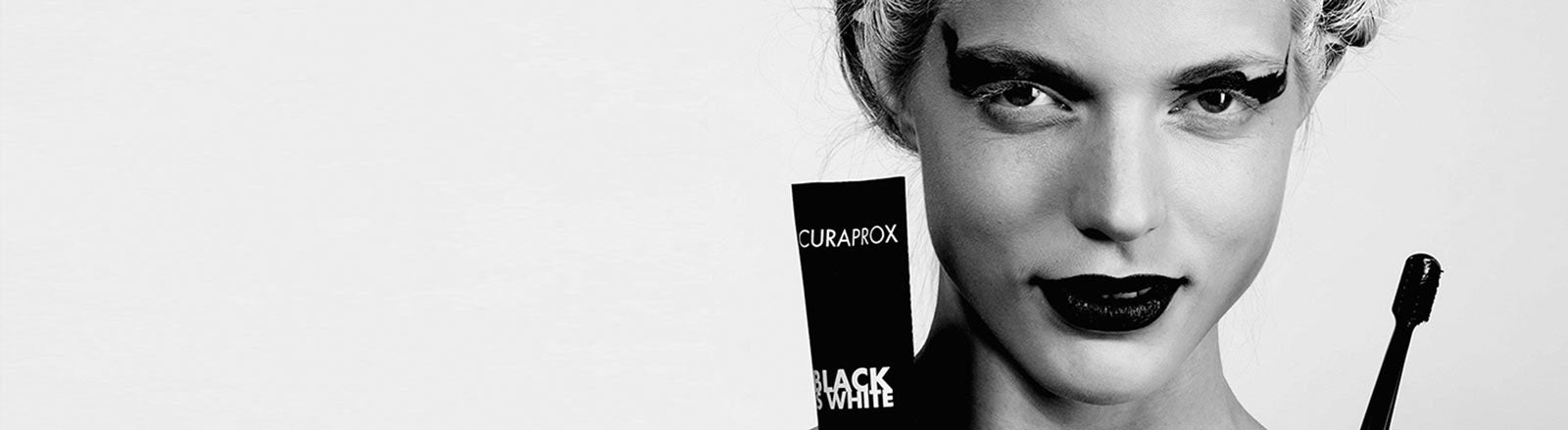 Woman holding Black is White products