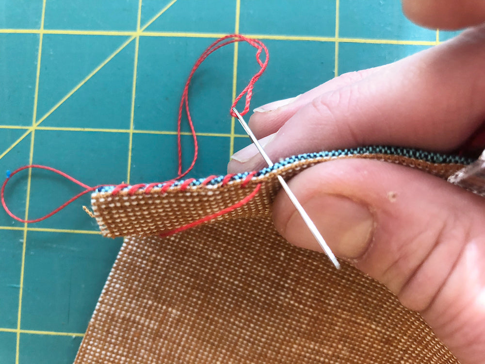 Showing the width of whipstitches