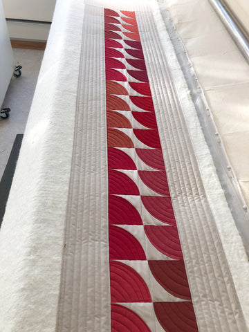 Long arm quilting of quilted table runner with Oakshott Fabrics Ruby Red bundle of shot cottons