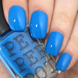 "Bright blue nail polish ""so right it's sarong"" from Pepperpot Polish"