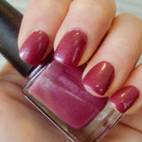 Brazen red nail polished modeled for Pepperpot Polish