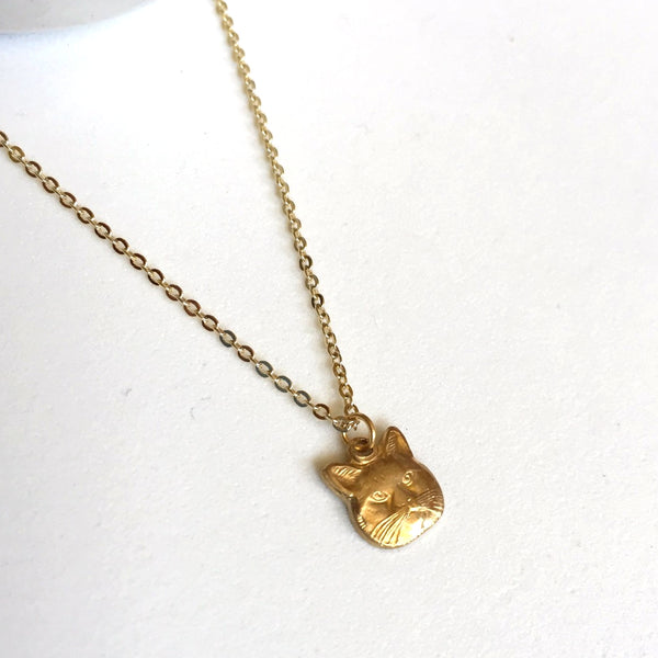 Tiny brass cat head charm necklace