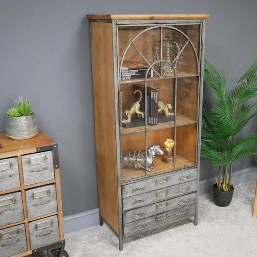 Industrial Distressed Metal Display Cabinet Industrial Style Candle and Blue Interiors
