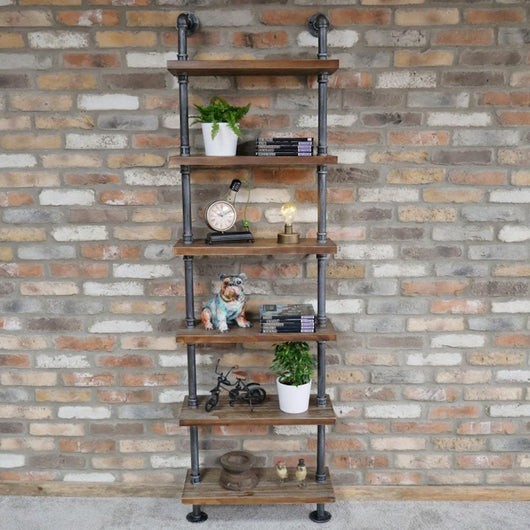 Pipe Detail Wooden Lean To Shelves Industrial Style Candle and Blue Interiors
