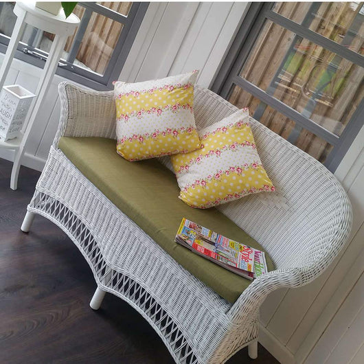White Wicker Loom Style Conservatory Sofa Conservatory Furniture Candle and Blue