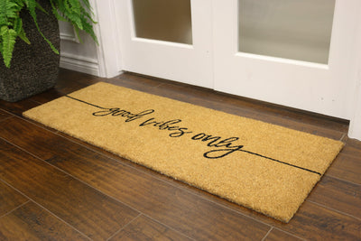 "Coconut fibre welcome mat with ""good vibes only"" written in cursive"