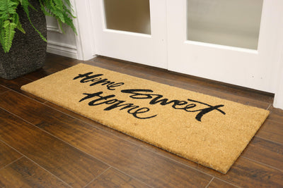 "Coconut fibre welcome mat with ""home sweet home"" written in cursive"