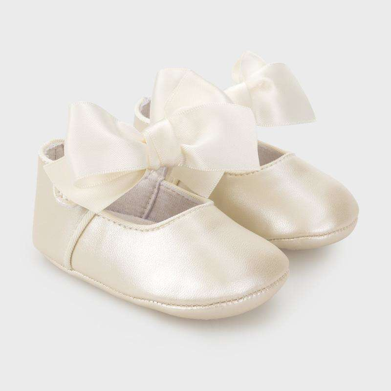 Adrian East online Ivory Mary Janes with Bow Accent