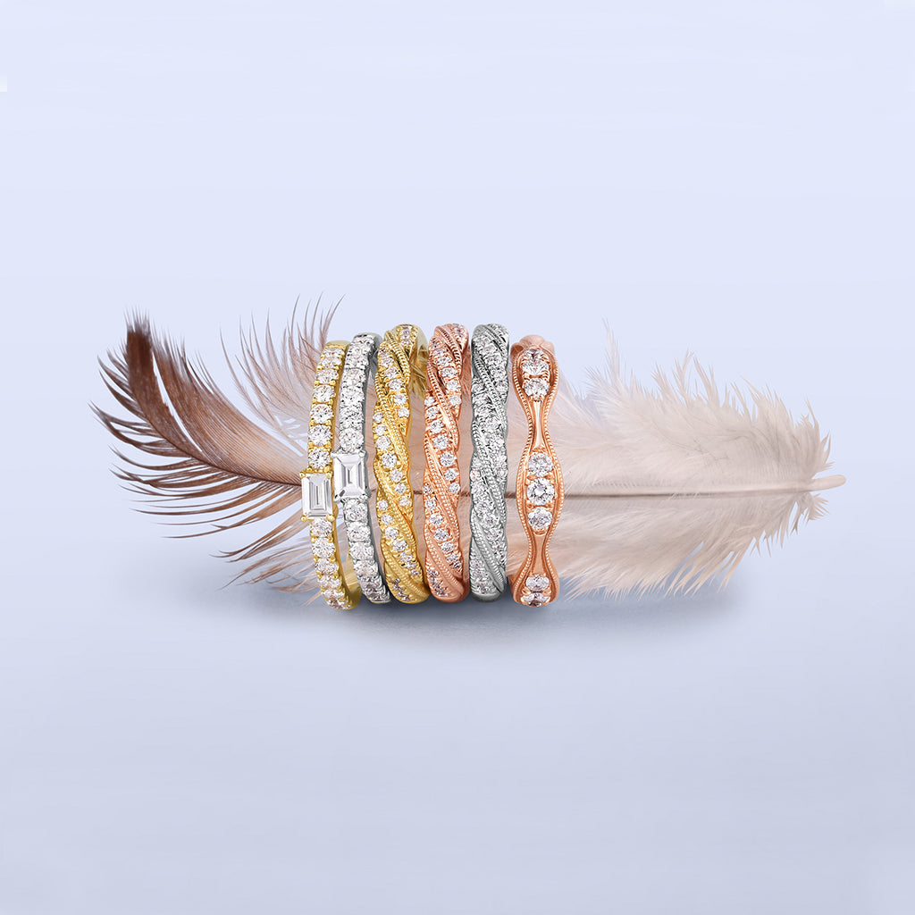 Little Bird Bridal rings with feather.