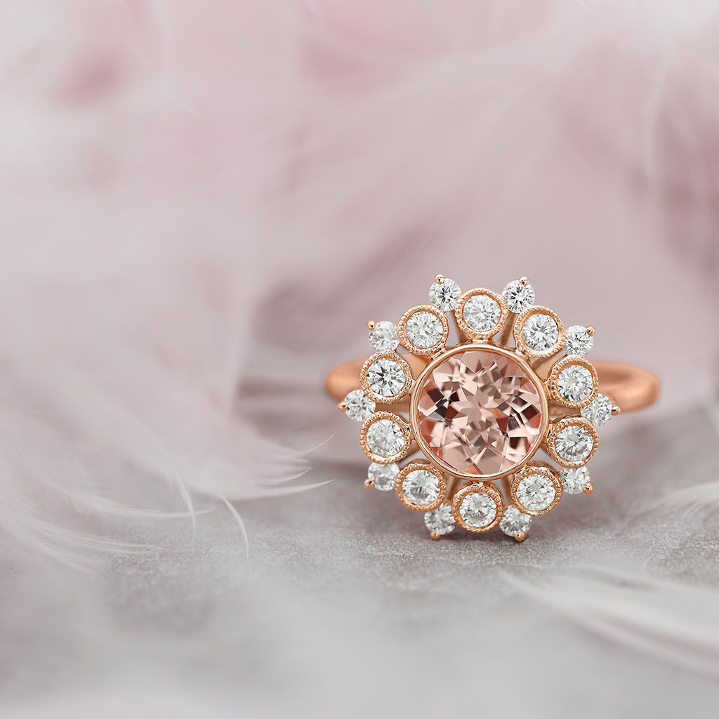 Little Bird Bridal ring on pink feather.