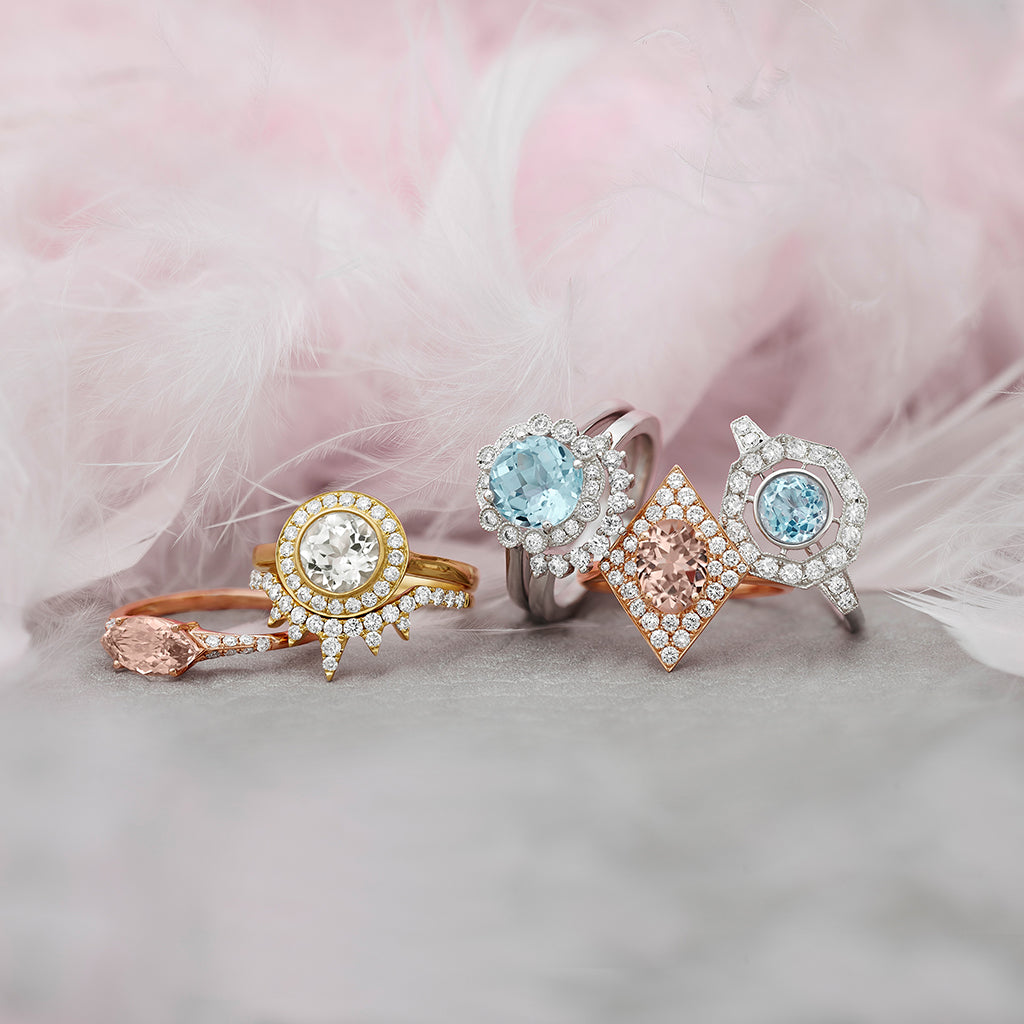 Little Bird Bridal rings spread on pink feather.