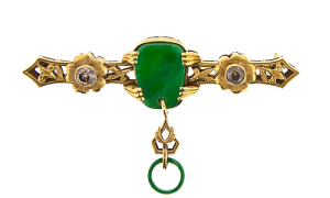 Jade and brown diamond pin, circa, 1920