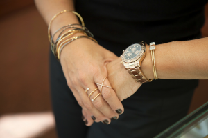 womans-hands-with-stacked-bracelets-watch-and-rings