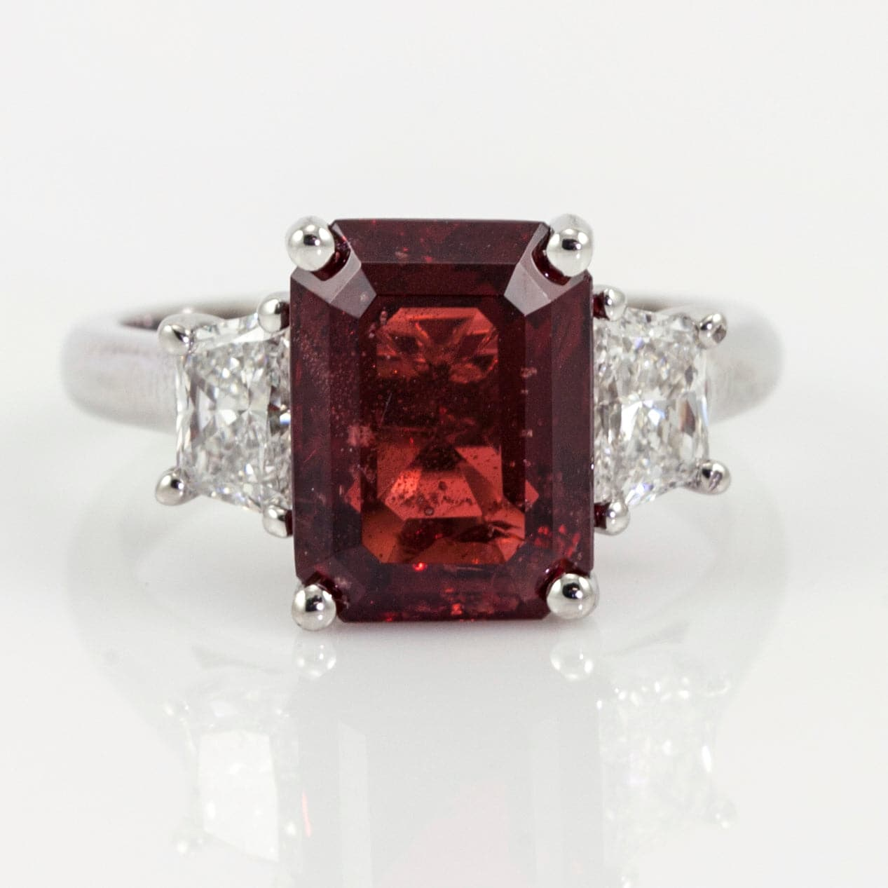 Platinum Red Spinel and Trapezoidal Diamond Three-Stone Ring