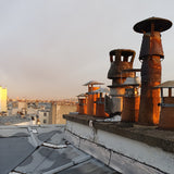 rooftop and chimney view of Paris towards Monmartre