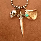 pendant set in silver, skull, dagger and smokey quartz with chrysoprase