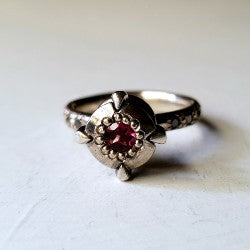 Victoria's solitaire - rhodalite garnet and black diamonds