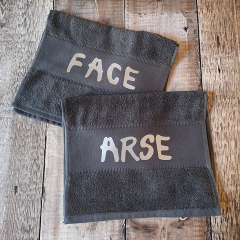 A pair of Face / Arse Towels 100% Cotton