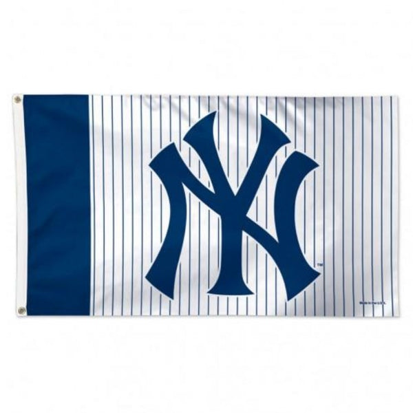 blue and white flag with pinstripes and the yankees logo