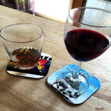 PHOTO SHOWING DIFFERENT TYPES OF GLASSES ONTOP OF VARIOUS COASTERS
