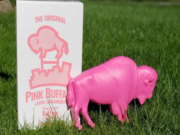 PINK BUFFALO LAWN ORNAMENT NEXT TO PACKAGE IN THE GRASS