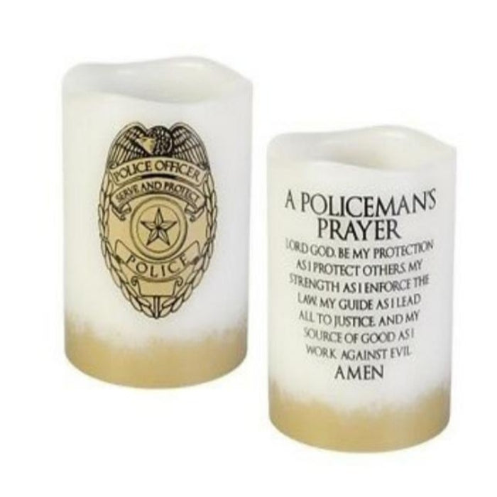 police badge on one side of the candle and a prayer on the other