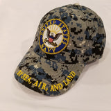 navy seal embroidered on blue camo hat with by sea air and land on brim