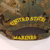marines embroidered black letter in yellow outline on green camo hat with marines on brim