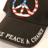 black hat with patriotic peace symbol give peace a chance