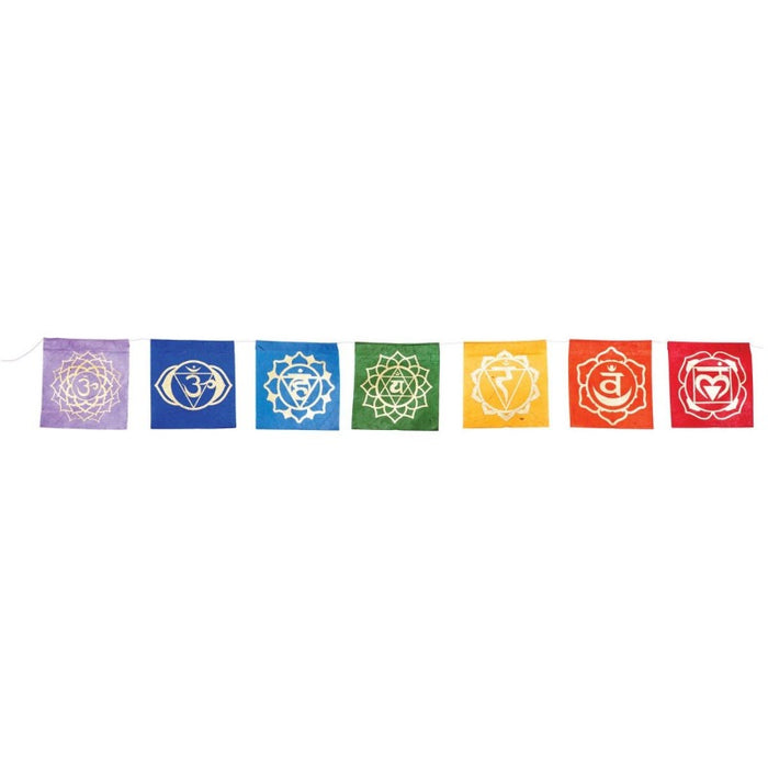 multi colored paper flags with different colored chakra symbols