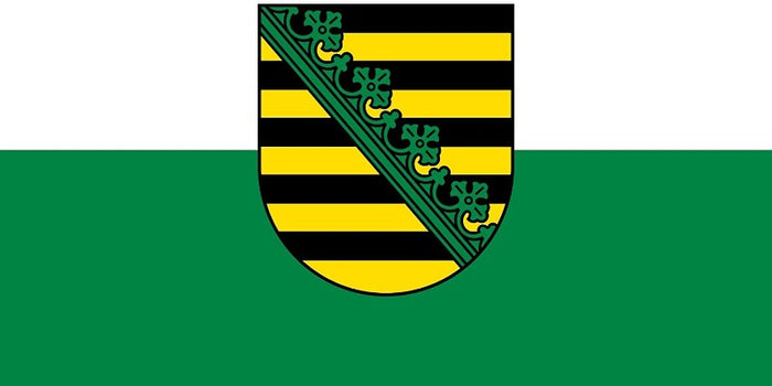 white and green flag with the saxony coat of arms in the center