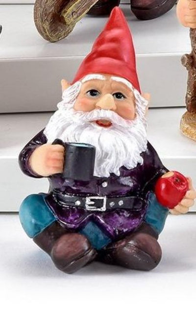 small gnome figurine holding a mug of water and an apple