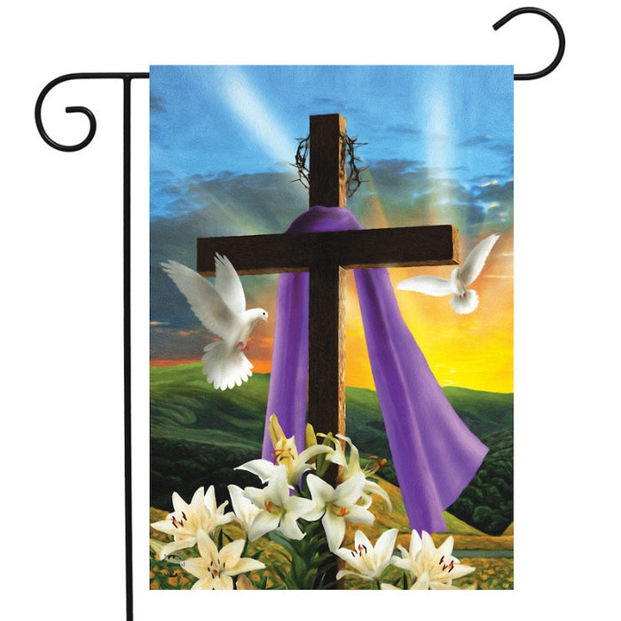 sunset on a flag with a cross and white doves and lilies